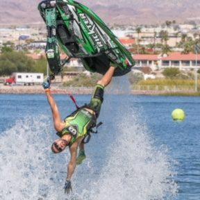 Tanner Tanman Thomas inverted on JetSki in water
