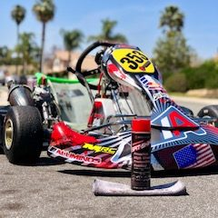 Stroker Industries Spit-shine auto protectant beside professional Go-Kart